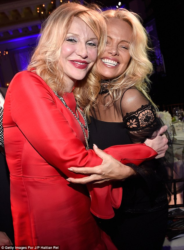 Warm embrace: Pamela caught up with her fellow A-listers at the Fundraiser including Courtney Love