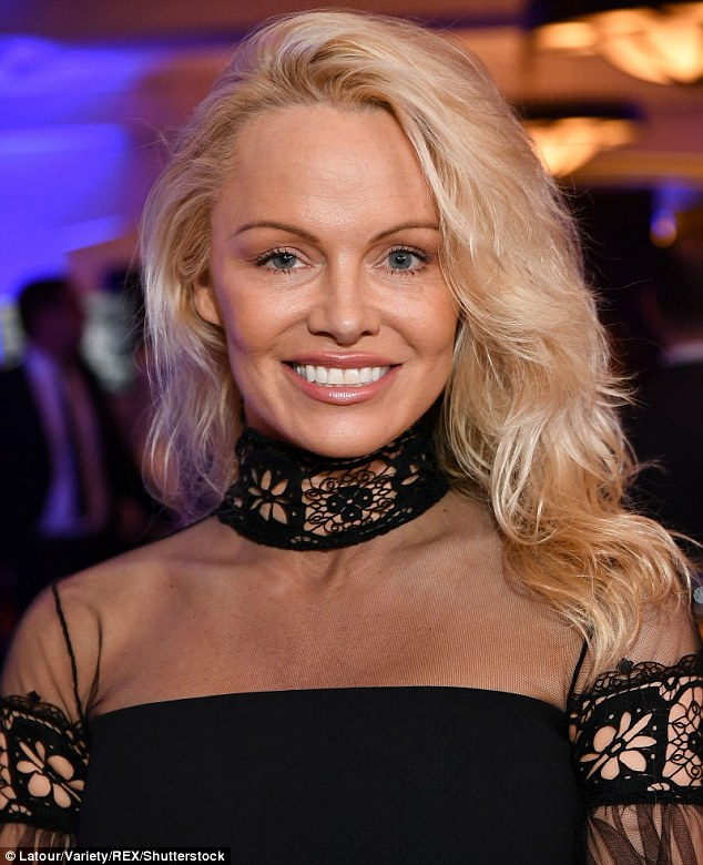 Simple yet sweet: The Baywatch star kept her blonde locks loosely curled and parted to the side as she wore natural make-up