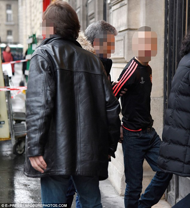 A suspect is pictured being taken to a police station in Paris last month after lengthy investigations into the robbery