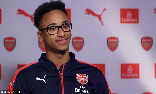 The 20-year-old full back is all smiles after joining Arsenal from non-League sideHednesford