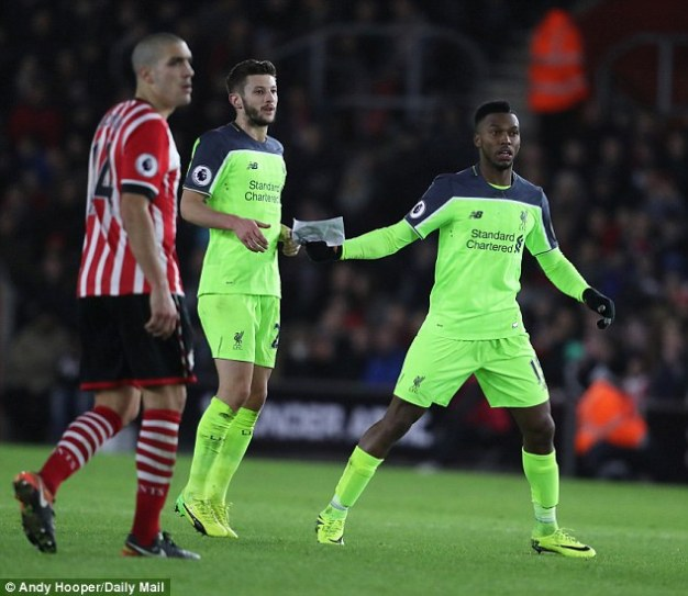 Sturridge tried to pass the note to Adam Lallana as play carried on around them