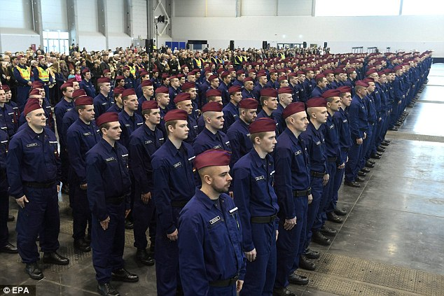 New border protection officers attend their swearing-in ceremony in Budapest