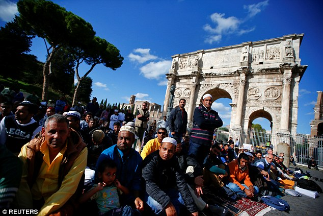 Muslims hold Friday prayers in front of the Colosseum in Rome, Italy October 21, 2016