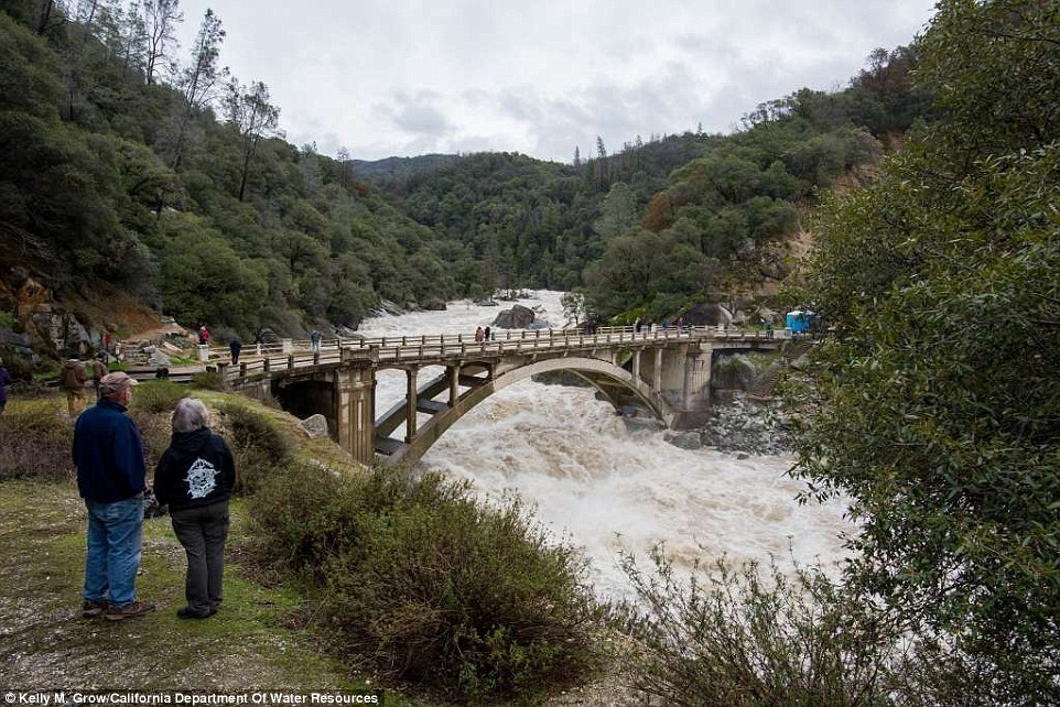 The friendly swimming hole is not looking so friendly in 2017 as water rushes under the South Yuba River Bridge due to the rainstorms