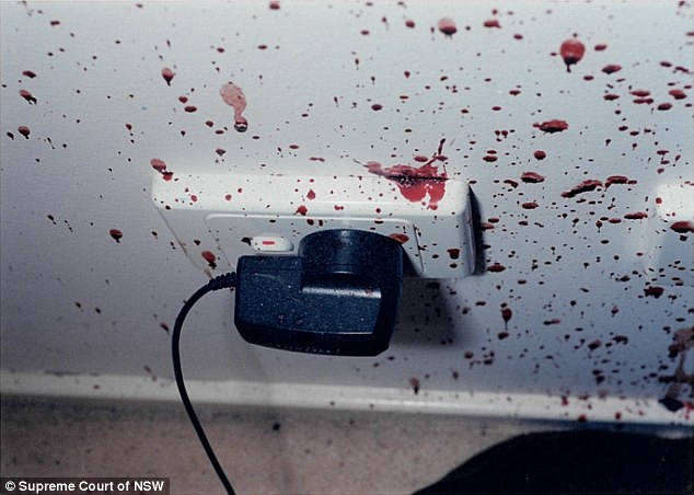 A mobile phone charger splattered in blood at the Lin family home