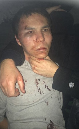 A photograph shows the moment Abdulkadir Masharipov was arrested in Istanbul, with blood on his face