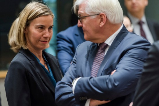 EU foreign policy chief Federica Mogherini, left, talks with German Foreign Minister Frank-Walter Steinmeier during an EU foreign ministers meeting at the EU...