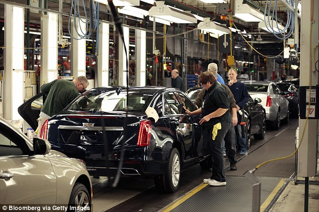 GM denied any future changes will be in response to Trump's bluster, saying investments of this magnitude are talked about and planned for 'some period of time'. Pictured is the constructive line at GM's plant in Lansing