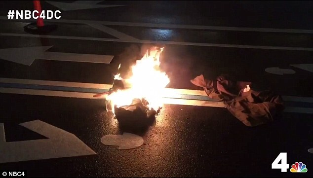 A man set himself on fire in protest outside Trump International Hotel in Washington D.C. on Tuesday night. His clothes remained ablaze in the middle of the road afterwards