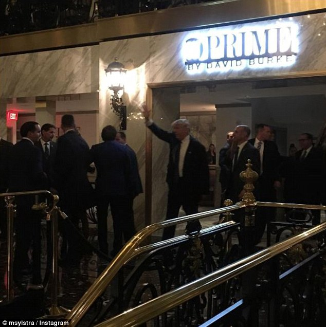 Trump was surrounded by security when he walked into his own hotel in DC on Wednesday night
