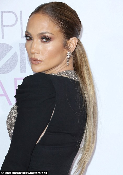 Stylish siren: The actress and chart-topping singer showcased her stunning features by tying back her long dark locks, whilst she highlighted her features with a subtle bronzed palette of make-up