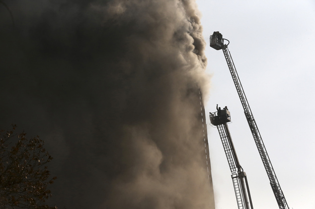 Iranian firefighters work to extinguish fire of the Plasco building in central Tehran, Iran, Thursday, Jan. 19, 2017. The high-rise building engulfed by a fi...