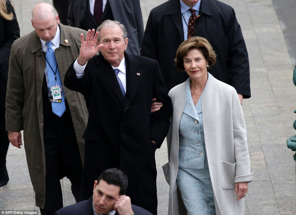 Former President George W. Bush and his wife Laura arrive at the Capitol Building on Friday. President Bush told reporters that his parents, former President George H.W. Bush and first lady Barbara Bush, are doing better at the hospital