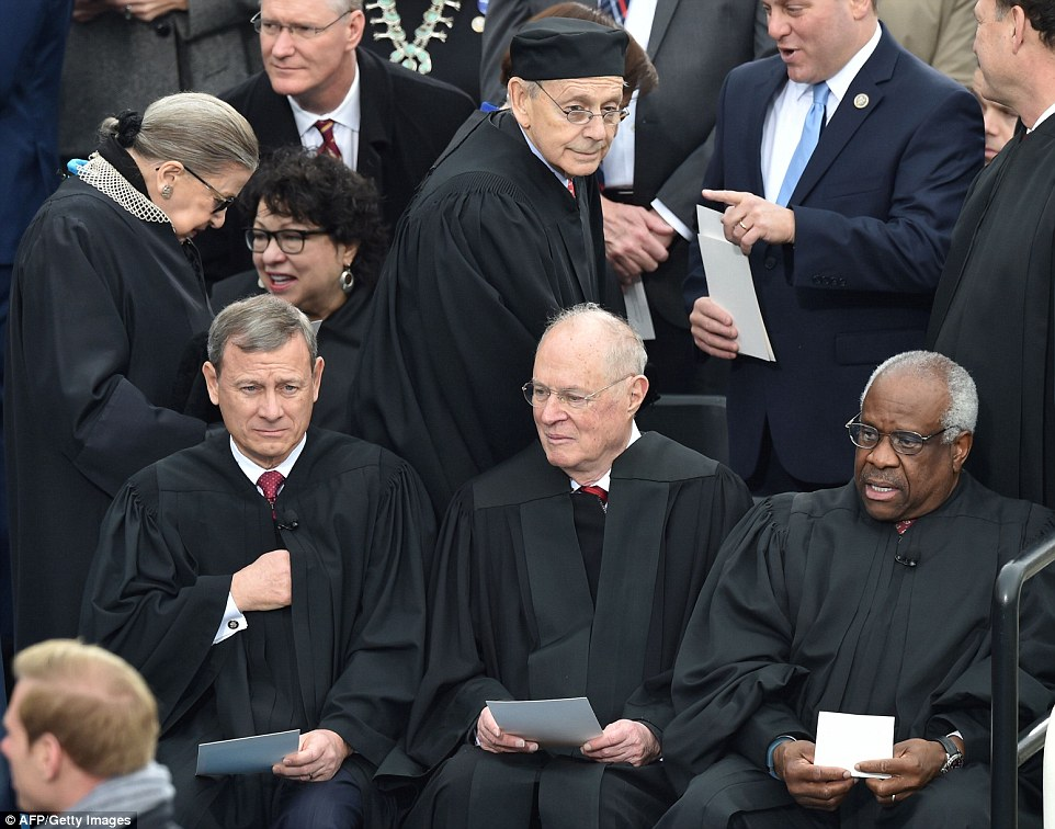 L-R(FRONT) US Chief Justice John Roberts, Justice Anthony Kennedy and Justice Clarence Thomas, Back L-R: Justice Ruth Bader Ginsburg, Justice Sonia Sotomayor and Justice Stephen Bryer on the platform of the US Capitol in Washington, DC, on January 20, 2017, before the swearing-in ceremony of US President-elect Donald Trump.