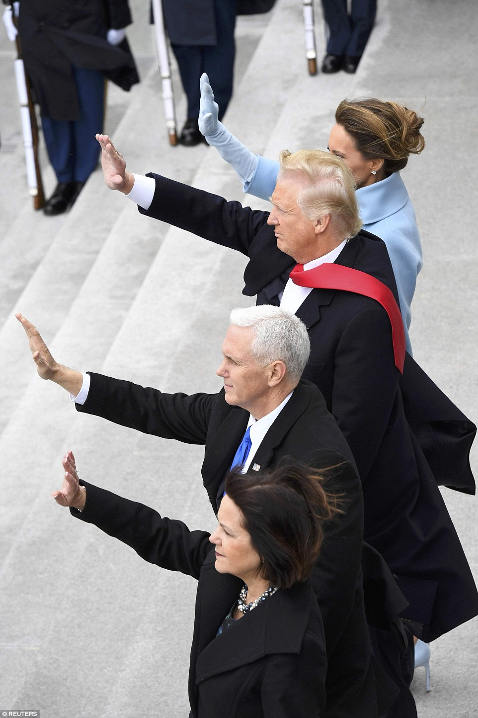President Donald Trump, First Lady Melania Trump, Vice President Mike Pence, and Karen Pence wave as former President Barack Obama and Michelle Obama depart during the 2017 Presidential Inauguration at the U.S. Capitol in Washington, D.C., U.S.