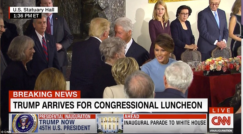 A perhaps awkward moment took place at the luncheon following the inauguration, when the president and first lady had to greet rivals Bill and Hillary Clinton