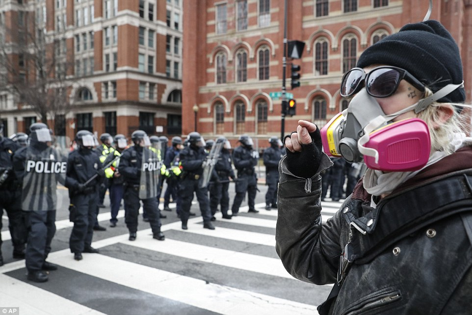 An angry protester faces off with a line of riot police during a demonstration in D.C.