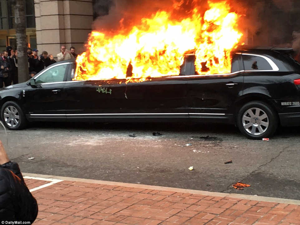 A limo was set on fire after masked protesters wearing all black threw a flare into the vehicle. They had reportedly run up to the car and smashed its windows in D.C. following Trump's inauguration