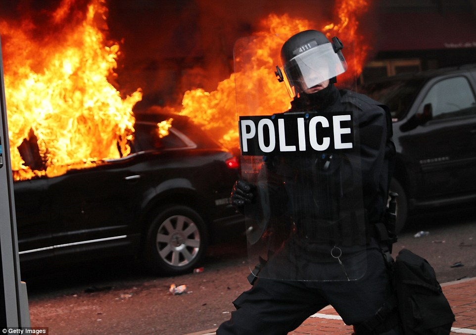 Riot police have arrested nearly a hundred people for the explosive protests in the streets of D.C. Washington police said numerous individuals were charged with rioting