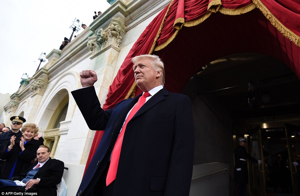 President Trump gave an enthusiastic fist pump as he appeared on the portico to cheers from waiting crowds. Former US Senator Bob Dole and his wife Elizabeth were among the first to see him