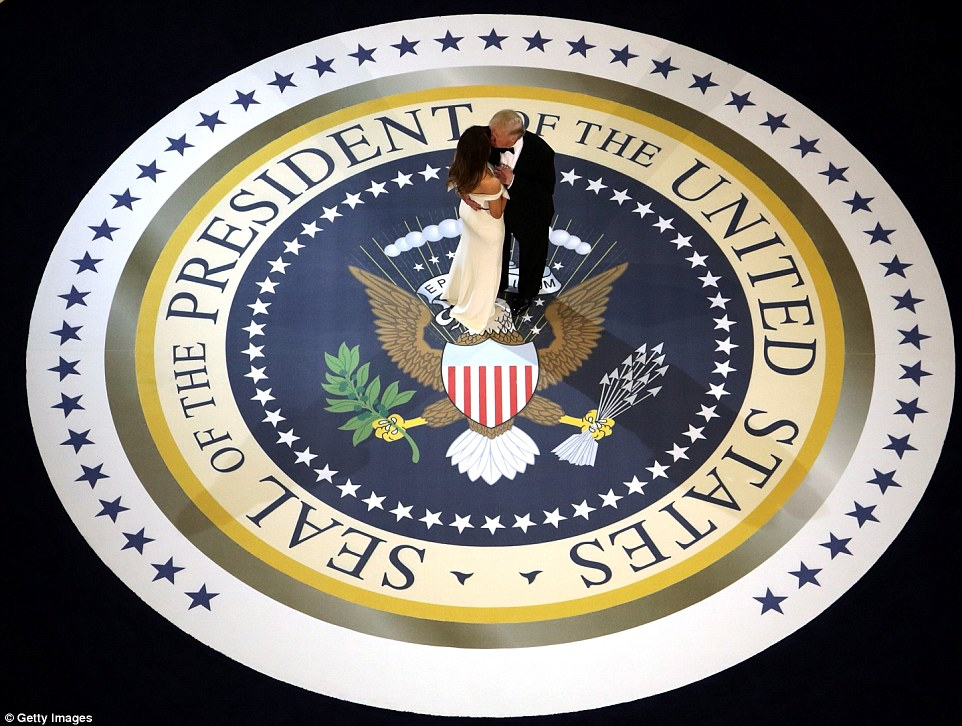 In a tender moment before they were joined by anyone else, the president planted a kiss on the first lady's cheek while they danced