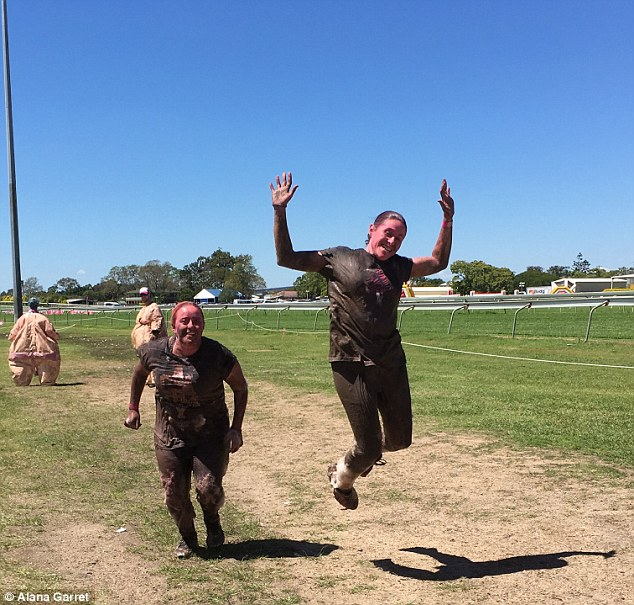 Jumping for joy! Since the surgery, the Brisbane woman has competed in Miss Muddy and publicly bathed naked in Japan