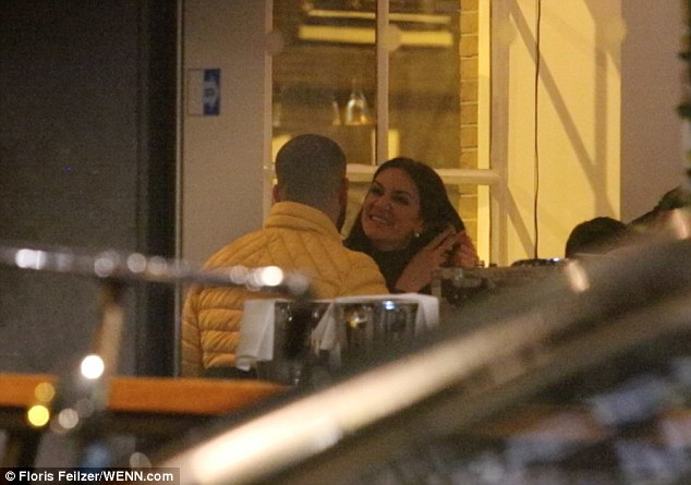 Two's company:Drake was enjoying the company of a pretty brunette as he went for dinner at a Japanese restaurant in Amsterdam on Monday