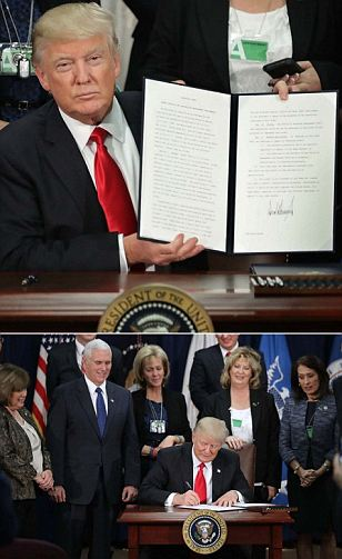 Trump defunds sanctuary cities, orders wall construction