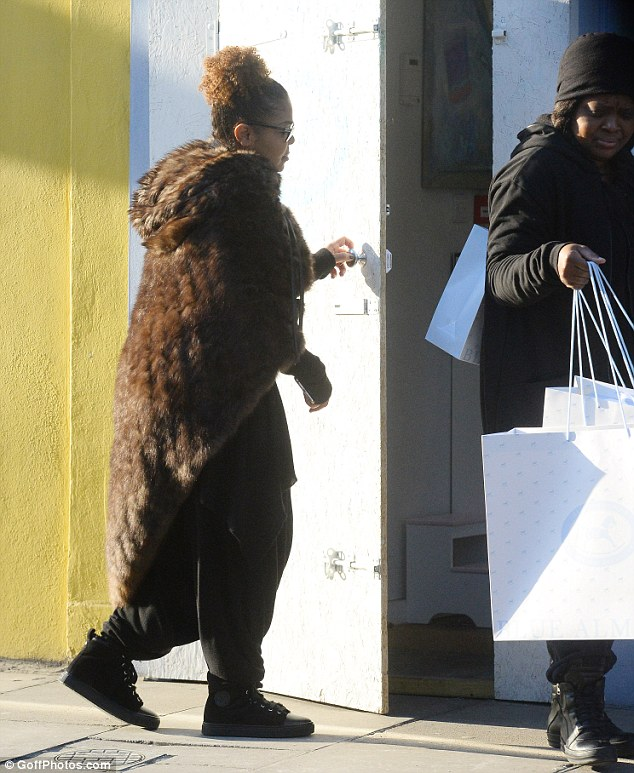 Shopping spree: The 50-year-old pop star was seen in London as she made several purchases at high-end baby boutique, Blue Almonds