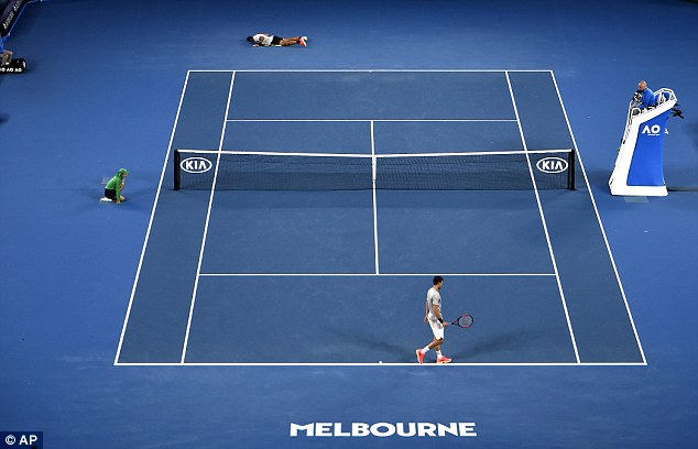 The Australian Open finalist falls to the floor after beating Dimitrov in the enthralling tie