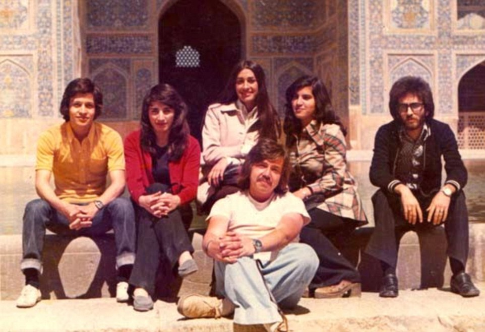 Sporting mullet haircuts and flares, a group of friends at Tehran university pose together in the 1970s