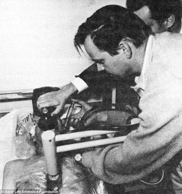 James Bedford (whose body is pictured on the white table) was the world's first cryopreserved human being. Robert Nelson, now 80 (pictured giving Bedford an injection) was one of a team of three that helped preserve his corpse