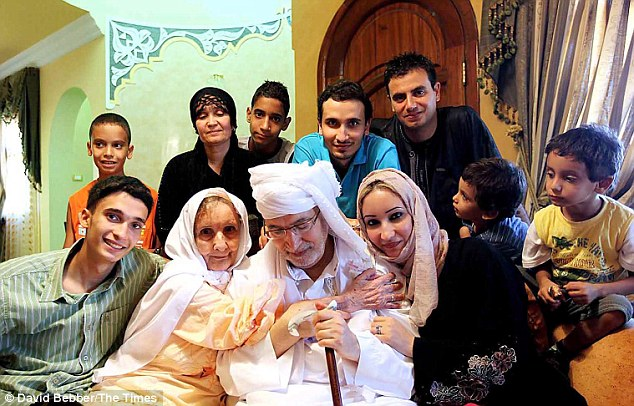 The freed Lockerbie bomber Abdel Baset al Megrahi is surrounded by his sons and grandsons and hugged by his mother and daughter at home in Tripol. The new appeal is backed by Mr Al Megrahi's  family and the British relatives of those who died in the atrocity