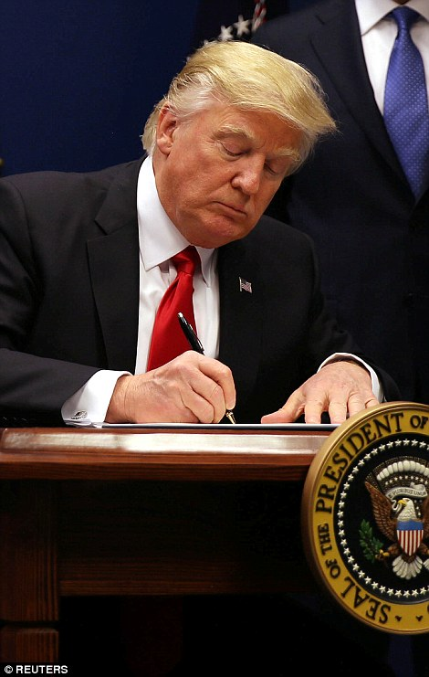 Donald Trump signs an executive order to impose tighter vetting of travelers entering the United States