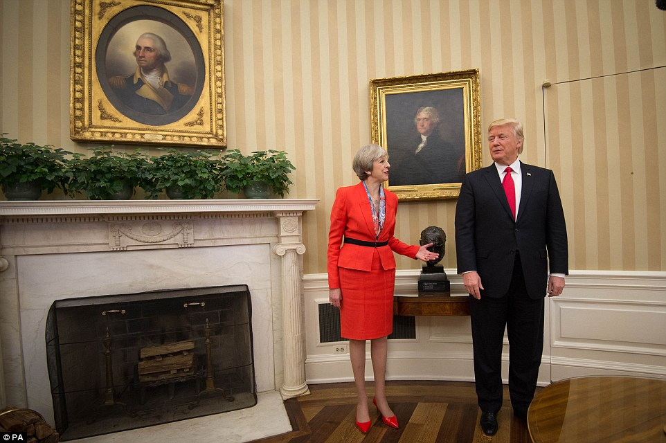 An official spokesman said Sunday UK leader Theresa May does 'not agree' with Trump's order and will challenge the US government if it has an adverse effect on British nationals. May is pictured in the Oval Office with Trump this week