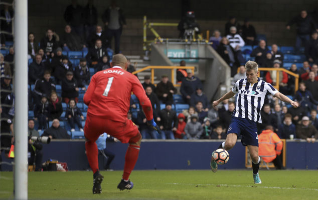 Millwall's Steve Morison scores his side's first goal of the game during the English FA Cup, Fourth Round soccer match, Millwall vs Watford at The Den, Londo...