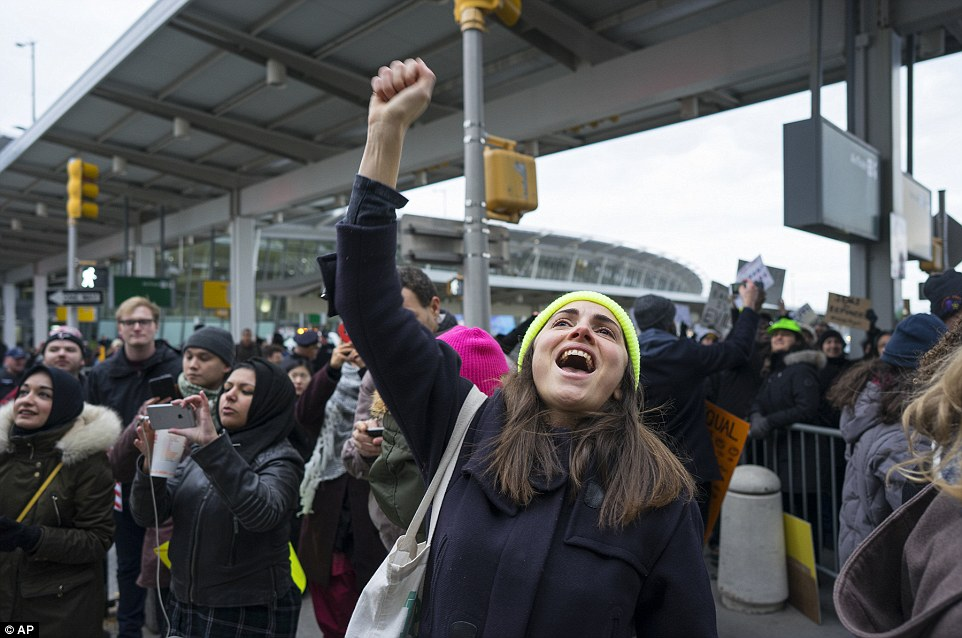 The protest at John F Kennedy International Airport carried on through Saturday as people remained detained