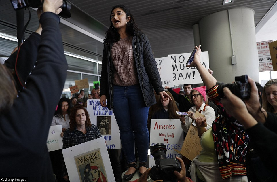 Kayla Razavi, whose family emigrated from Iran, addressed the crowd during the San Francisco protest Saturday afternoon