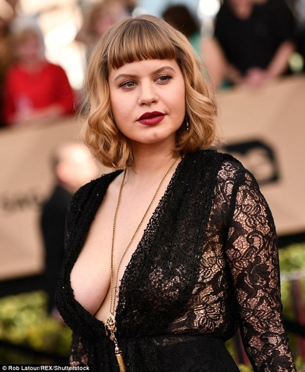 Risking it: Orange Is The New Black star Emily Althaus went braless in an extreme plunging black lace gown at the SAG Awards at the Shrine Auditorium on Sunday night