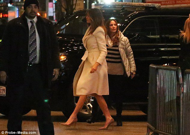 Melania Trump looked glamorous in nude colored heels, and a knee length white coat