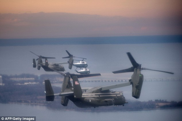 Marine One flew with a decoy and support helicopters to Dover Air Force