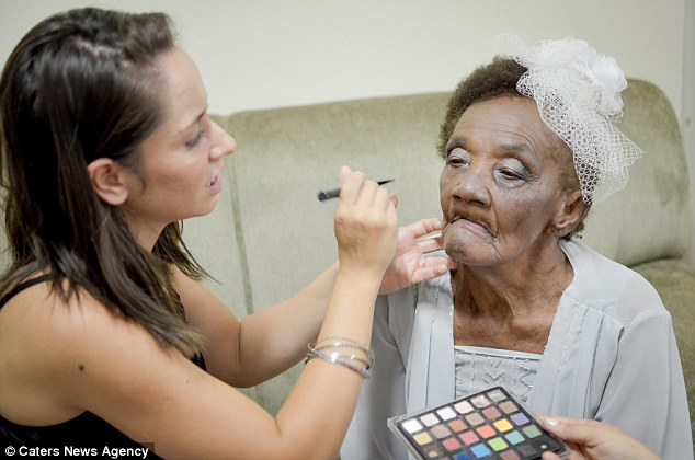 Valdemira Rodrigues de Oliveira gets her make-up done ahead of the big ceremony in Brazil