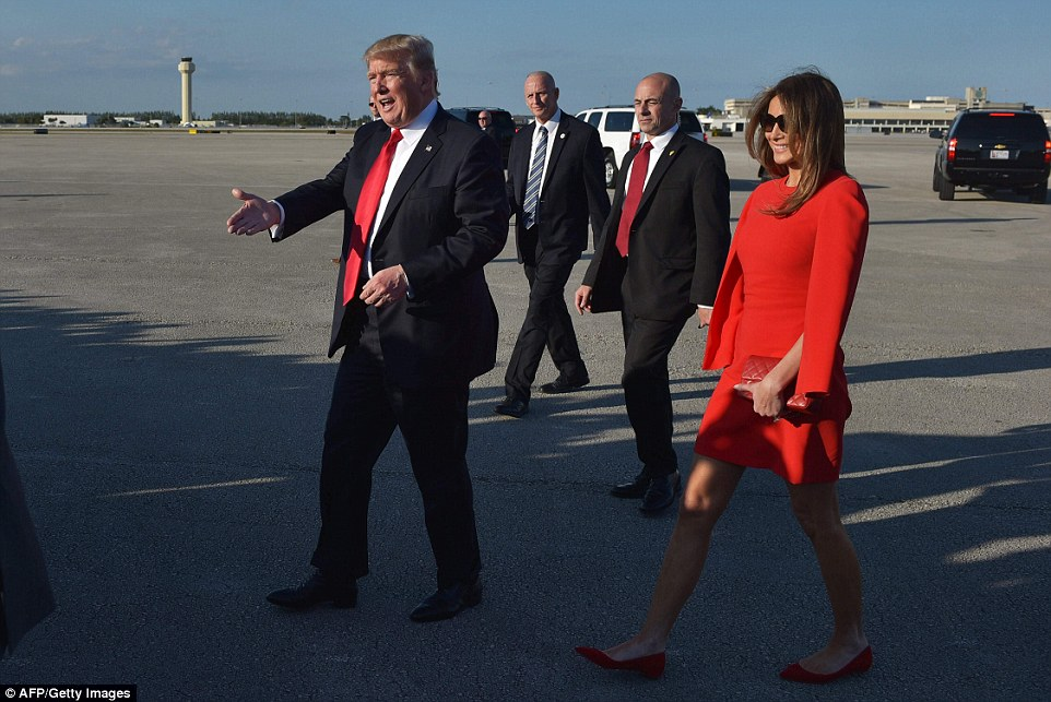 REUNITED:President Donald Trump and wife Melania make their way across the tarmac to greet well-wishers upon arrival at Palm Beach International Airport in West Palm Beach