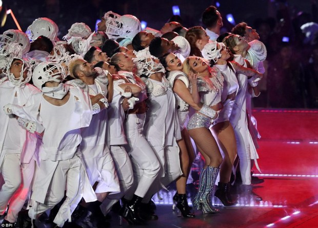 And everyone move right... :  Lady Gaga and her troupe of backup dancers shimmy across the stage at the Super Bowl half time show