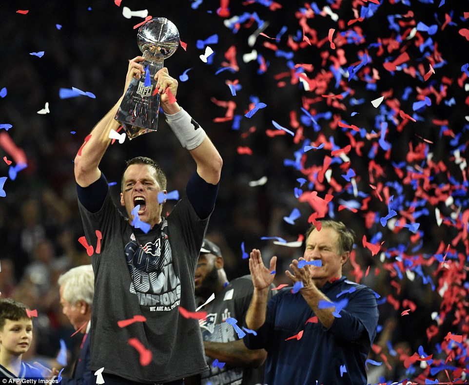 Five with his guy: Belichick applauds Brady as he lifts the Lombardi trophy over his head for the fifth time since 2001