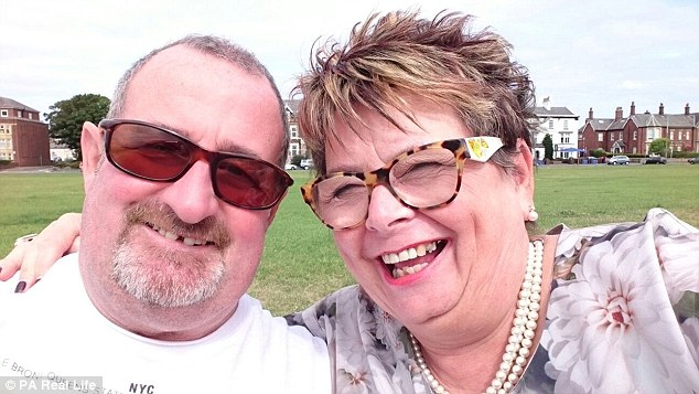 Now she is appealing for people to support her claims that she developed the disease through washing dust off Mr Power's clothes (pictured with her partner, Ian Johnston, 63)