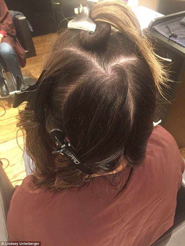 Section, section, section: The key to a good blowout is separating hair into five neat sections and working on them one at a time