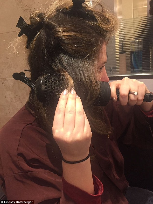 That's a wrap: For hair that looks modern, wrap sections loosely around the brush, leaving out the ends, before brushing through and blowing dry