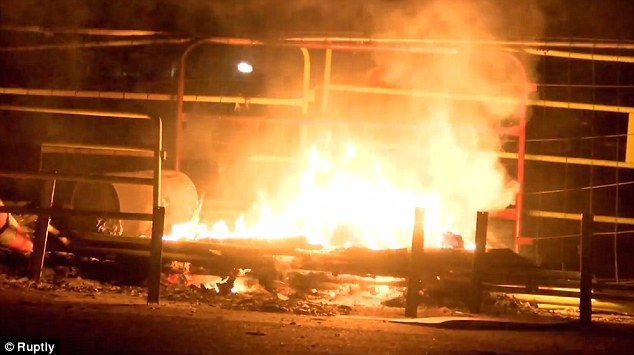 A car dealership and a nursery school were set alight during a third night of rioting in the French capital on Monday