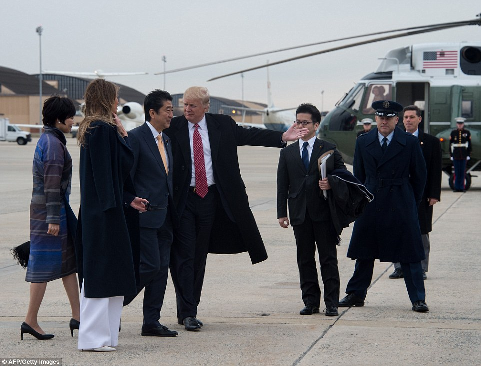 Family greeting: Melania Trump was on the ground at Andrews Air Force Base as her husband arrived with Japanese Prime Minister Shinzo Abe and his wife Akie Abe